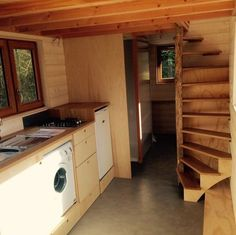 This is a tiny house on wheels by La Tiny House with a nicely designed staircase to the loft. You'll notice it's a custom, spiraling staircase that helps you get to the loft safely. Thi…