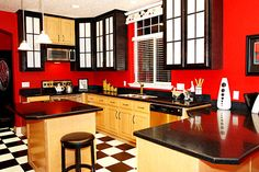 MY DREAM KITCHEN!! Red accent walls, dark counter tops, black and white checkered floor. LOVE