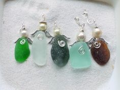 Beach glass angels - from the shores of Lake Erie! Beautiful little angels, crafted from naturally tumbled glass. Wear as a necklace, use as an ornament for your Christmas tree, give as a housewarming gift, hang as a sun catcher, embellish gift wrappings, or...well...use your imagination!