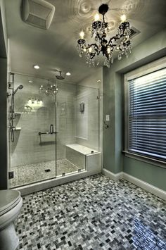 love this bathroom....chandelier and floors!