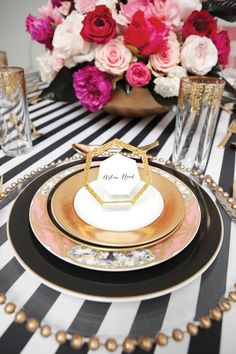 More cool black gold and white place settings.  Interesting idea for a table cloth.
