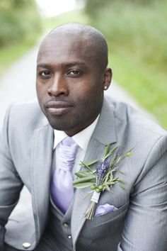 purple and gray groom with lavender boutonnière