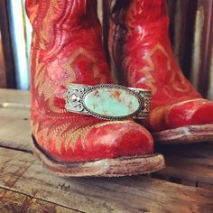 Native American handcrafted sterling silver and turquoise cuff Entricate southwest pattern that is a one of a kind design that differs on both sides Detail is h