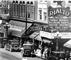500 block of Main Street 1922 where the Johnson Building stands 2012. This photo shows the Rialto, and Porter Furniture (before it added an (s) =Porters, and moved to Sixth Street).