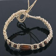Very tropical bracelet or anklet. This Hawaiian Style piece is made from shell, bone and leather. The perfect gift idea!