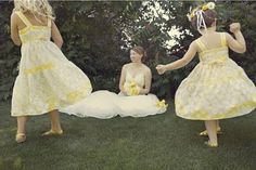 Pale yellow sundress for the flowergirl, methinks.  I've got a yellow lace parasol to match...