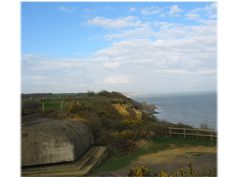 The beauty of the Normandy coast marred by the presence of a German fire control bunker. This fire control bunker was well concealed in the bluffs above the English Channel at Longues-Sur-Mer, Normandy
