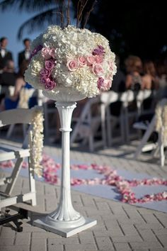 Want a spectacular wedding ceremony entrance? Use tall centerpieces to line the wedding aisle. After the ceremony, your florist can transport the centerpieces to your reception and place them on guest tables. Dual-use flower arrangements! #hydrangea #roses