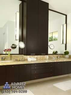 The Crystal Contemporary Bathroom by Tampa New Home Builders Alvarez Homes - (813) 701-3299.  Fabulous master bath!  Love the countertops.    http://www.alvarezhomes.com/tampa-home-builders-portfolio-of-homes/the-crystal