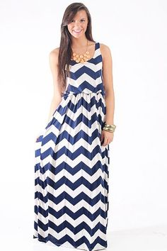 "The Hamptons Maxi, Navy $45.00 We love the feel of this classic maxi! The material is so comfortable and the chevron pattern is right on trend!   Fits true to size.   From shoulder to hem:  Small- 57""  Medium- 58""  Large- 59"