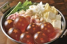 """""""Dragon Ball Nabe"""" - the balls using collagen jelly and the tiny stars are made using carrots."""