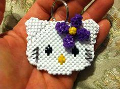 Hello Kitty w purple flower II by doggie-dew on DeviantArt