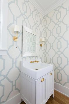 Camille Long Sconces flank a capiz beveled mirror hung from a wall clad in white and blue trellis wallpaper over a light gray plank washstand. Home Decor Inspiration, Home Decor Accessories, Room Wallpaper, Home Decor, House Interior, Powder Room Wallpaper, Bathroom Decor, Blue Trellis Wallpaper, Manufactured Home Remodel