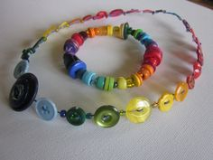 #Upcycled rainbow button necklace and bracelet. Made with #salvaged telephone wire and buttons.
