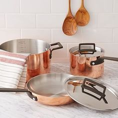 Copper and brass can live together in harmony - just pepper them around evenly so  it looks intentional enough.