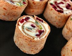 Cranberry Feta Pinwheels  1 pkg dried sweetened cranberries      1 container cream cheese spread      1 cup crumbled feta cheese      1/4 cup chopped green onion      4 large flour tortillas or 4 large wheat flour tortillas or 4 large spinach tortillas    Directions:        1 Combine all ingredients except tortillas, mix well.      2 Divide and spread mixture evenly among tortillas.      3 Roll up tightly, wrap in plastic and refrigerate at least one hour.      4 To serve cut into 12 slices