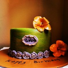 Chocolate cake with edible decorations made from marshmallow fondant.