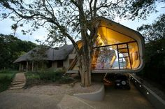 Wright Conversion by South African architects Elmo Swart Architects is an expansion project to a three-bedroom thatch cottage in Durban, South Africa. Thatched House, Thatched Roof, Elmo, Glass Wall Design, Outdoor Bathrooms, Architectural Section, Rustic Contemporary, Contemporary Homes, Romantic Cottage