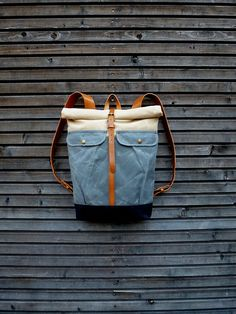 Waxed canvas backpack with roll to close top