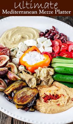 Take your party platter game to the next level! Learn how to build the Ultimate Mediterranean Mezze Platter. A simple guide and video show you how to assemble favorite Mediterranean dips like hummus, tzatziki, or baba ganoush along with other Mediterranean favorites to make an epic platter that is a healthy and sure way to impress company! #mediterraneanrecipes #mediterraneandiet #mezze #partyplatter #hummus #tztaziki #babaganoush #appetizers #partydip #mediterranean