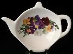 This is a Royal Patrician, England teapot shaped bone china tea bag holder or teabag caddy. multi colored pansies or violas. The teabag holder was made in 2006 and is no longer available because the pottery has closed Tea Pot Set, Tea Strainer, Teapots And Cups, Tea Art, China Painting, Tea Accessories, China Patterns, Tea Ceremony, Pansies