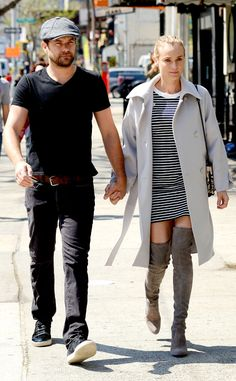 Stunning in over-the-knee suede boots, the fashionista takes a stroll in NYC with her handsome boyfriend.