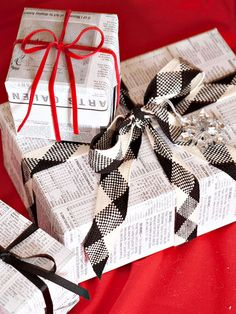 Love the black and white ribbon! gift wrapping ideas newspaper, christma gift, christma wrap, black white, christmas gift wrapping, newspaper wrapping, black and red christmas, recycled wrapping, christmas gifts