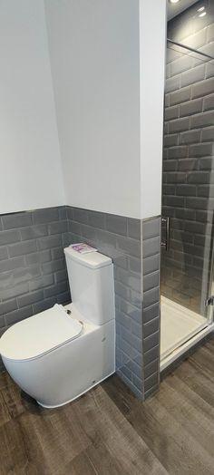 Blue, Grey and White Bathroom Transformation in Horley, Surrey - Blok Designs Ltd Fitted Bathrooms, Luxury Bathrooms, Marine Blue Color, Grey And White, Blue Grey, White Bathroom, Glass Shelves, Vinyl Flooring, Surrey