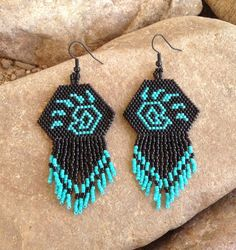 Here are some Native Bear Paw beaded earrings with fringe. Very light weight to wear. They are 3 1/2 inches long with silver French hooks and 1