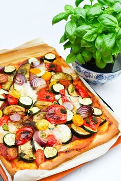 A recipe for the most amazing dairy free pizza, generously topped with roasted vegetables, dairy free cream cheese, pesto and fresh basil. Vegetarian Dinners, Vegan Dinner Recipes, Vegan Recipes Easy, Veggie Recipes, Vegetarian Recipes, Cheese Free Pizza Recipes, Simple Recipes, Vegan Meals, Vegan Food