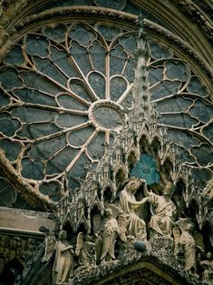 """lucaciakent: """"Architectural details of Reims Cathedral, a masterpiece of the gothic art, France (by Simon Greig)."""" it must be so wondrous and charming in a gloomy sort of way when the water from the rain falls upon the glass. Notre-Dame de Reims, France (1211-1311)"""