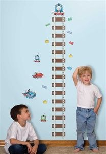 All aboard! Watch your little Thomas enthusiasts grow with this ultra cute Thomas the Tank Engine and Friends Peel and Stick Growth Chart. Stick the chart on any wall, door, or mirror, and use the additional decorative elements as repositionable markers