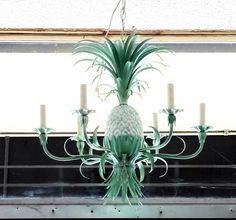 Hollywood Regency Tole Pineapple Chandelier It is mint green and white with 6 arms. It can easily be painted any color. It measures approx. 27h x 24 Chandelier is in good vintage condition. Shipping costs provided upon request.