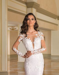 Justin Alexander 8870 Beading incorporated into vintage lace details appear throughout the Sabrina neckline, lace appliques on the sheer sleeves, low illusi Bridal Lace, Bridal Gowns, Wedding Gowns, Prom Dress Stores, Prom Dresses, Justin Alexander Bridal, Sophisticated Bride, Pageant Gowns, Prom Girl
