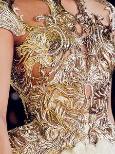 Incredibly fine and detailed workmanship results in spectacular bodice.