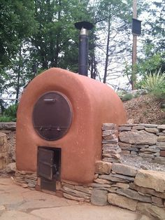 Barrel Oven- heat up faster than cob ovens with much less wood.