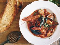 Italian Seafood Stew In this luscious seafood stew, calamari is cooked slowly until it becomes supertender and adds tremendous flavor to the tomato-rich broth. Seafood Recipes, Wine Recipes, Soup Recipes, Cooking Recipes, Biryani, Korma, Cooking Calamari, Italian Seafood Stew, Seafood Soup