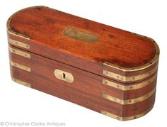 Antique Brass Bound Tea Caddy   This mahogany, brass bound tea caddy was not made with domestic use in mind. It was made to full fill a role and the two removable containers to the interior, although well made, considered practicality over sophistication.  It is a good looking Georgian box. Early 19th Century.