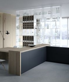 Fenix beautiful black and wood kitchen. Modern and simple.