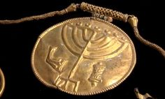 """Gold menorah medallion - part of a 1,400 year old gold treasure trove, unearthed at the foot of Jerusalem's Temple Mount - a """"once in a lifetime"""" discovery!"""