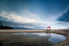 playing on the beach by dewan irawan on 500px
