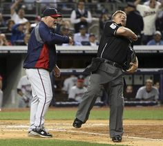 Umpire Greg Gibson, right, ejects Minnesota Twins manager Ron Gardenhire during the third inning of a baseball game between the Twins and the New York Yankees at Yankee Stadium in New York, Tuesday, April 17, 2012