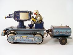 One of the most coveted of all Japanese non-robotic space toys is Nomura's battery operated Mobile Space T.V. Unit with trailer. This embossed tin litho battery op toy epitomizes the combination of the early space-race craze with with the exploding infatuation with television.  Mint in box sells for over $6000.