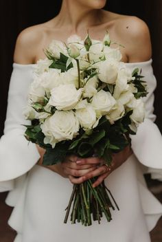 05 a white rose wedding bouquet is classics and elegance that never go out of style and look amazing - Weddingomania Long Flowers, Bride Flowers, Bride Bouquets, Wedding Flowers, Flower Bouquets, Summer Wedding Bouquets, Rose Wedding Bouquet, Bridesmaid Bouquet, White Rose Bouquet