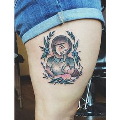 Beautifully done breastfeeding tattoo -- love how it is framed with leaves and flowers. http://thestir.cafemom.com/baby/191283/15_tattoos_that_pay_homage