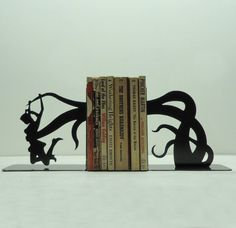 I need more bookcases to make room for these bookends instead of squeezing books in every which way.