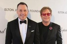 Sir Elton John and his husband David Furnish showed off their two-year-old son Zachary to the celebrity guests at the 'Rocket Man' singer's 21st Annual Oscars Viewing Party