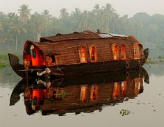 These houseboats ply the backwaters of Kerala. They were originally used as cargo boats until trucks took over. With the boom of tourism in the area recently, the number of these boats has skyrocketed.    This was taken at dawn near Allapuzha.