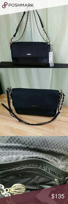 """DKNY Bryan Park Saffiano Leather Medium Bag DKNY Black Saffiano Leather Bryant Park Medium Flap Crossbody Bag,  size medium, color black, made of Saffiano Leather, gold hardware, measure's 11""""L ? 7.5""""H x 3"""" D with 11.5 strap drop, 1. Zipper pocket and 1. multi-use pocket inside, gold signature logo, 1. Outside pocket with magnetic closure, gold-tone chain and leatherstrap accent, gold-tone lettering front logo, compare $248.00 store retail price value, comes new with tag as closeout item in…"""