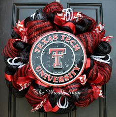Texas Tech University Mesh Wreath - Red Raiders Black and Red Deco Mesh Wreath accented with ribbons and a round metal Texas Tech logo sign